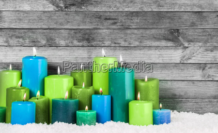 azul y verde velas encendidas navidad