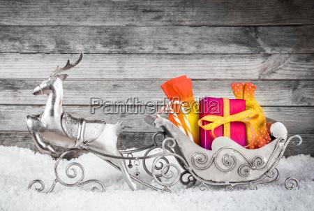 renos de plata y santa trineo