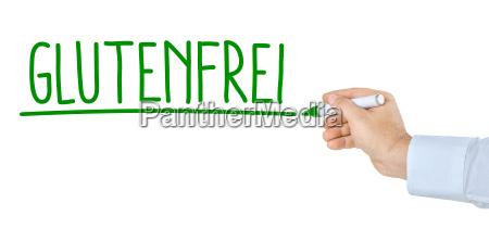 hand with pen writes gluten free