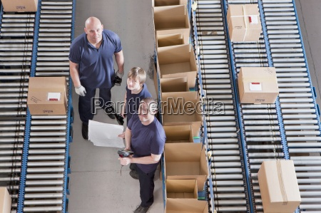 portrait of workers packing boxes on