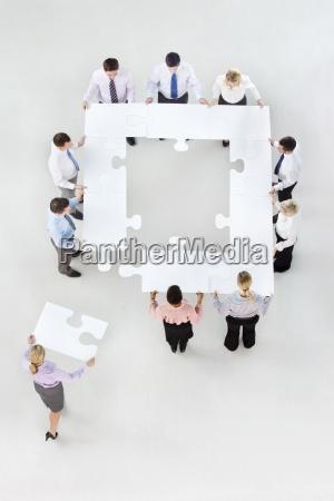 la gente de negocios que forman