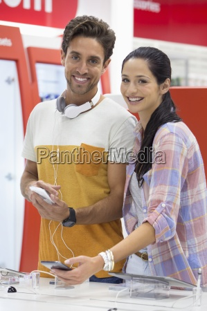 portrait of smiling couple looking at