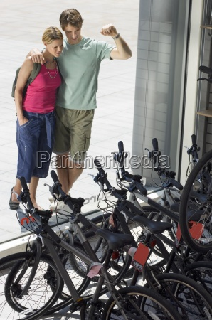 young couple looking at new bikes