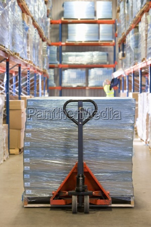 boxes wrapped in polythene on pallet