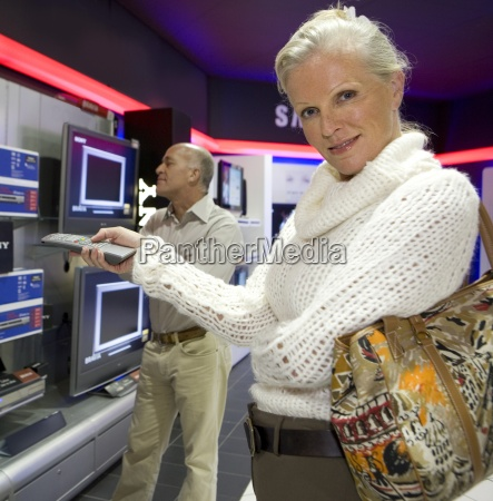 mature couple shopping in television store
