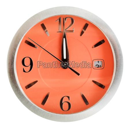 one minute to twelve oclock on