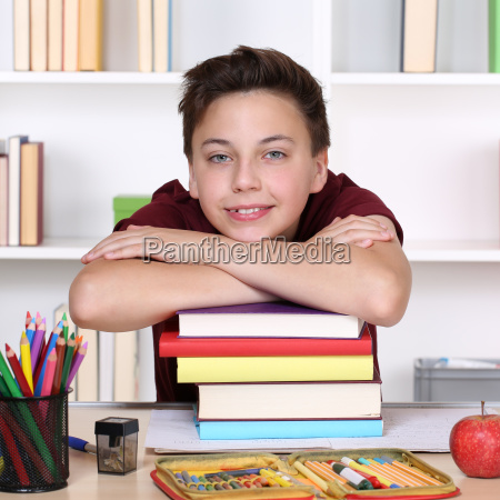 laughing student and a stack of