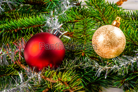 christmas baubles on pine