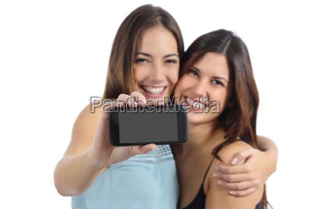 two friends showing a blank smart