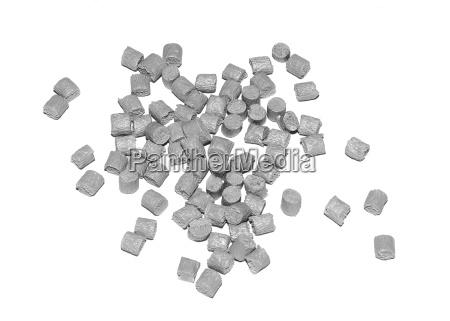 varios granulos de plastico plastico