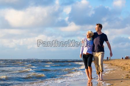 couple walk on the north sea
