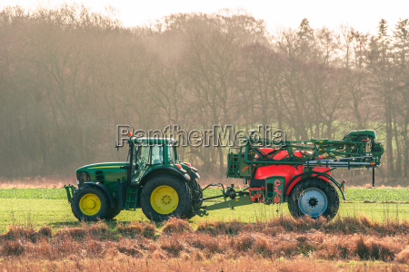 tractor on a field with ferilizer