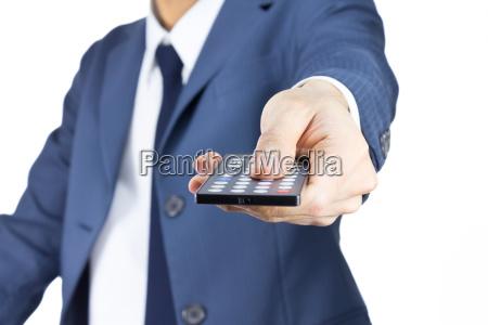 hombre de negocios con control remoto
