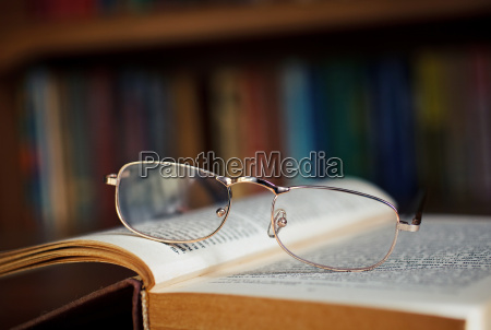 glasses on a book