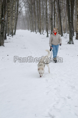 woman with dog walking down the