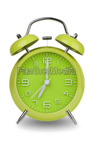 reloj de alarma verde con las