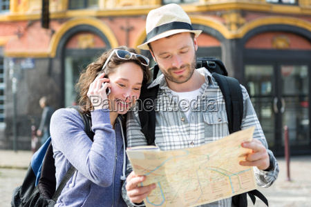 couple of young attractive tourists watching