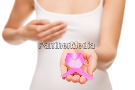 woman holding a pink cancer awareness