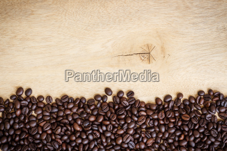coffee beans blank on wood background