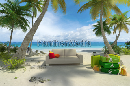 sofa on the beach with luggage