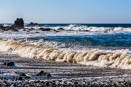 waves and foam on wild beach