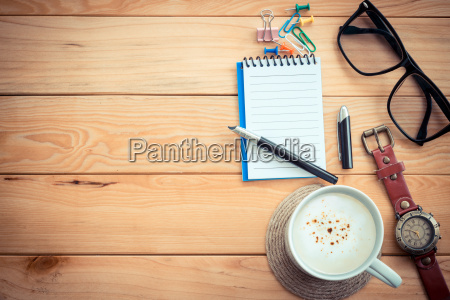 coffee cup on workspace wood table
