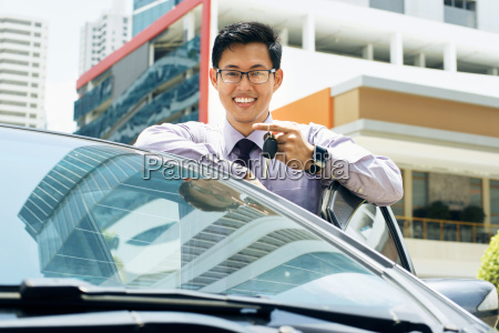 happy young asian man smiling showing