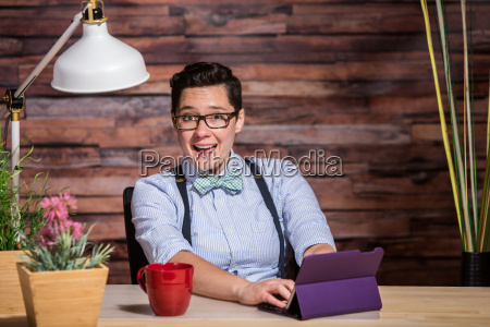 laughing woman having fun at desk