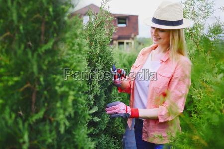 female cutting branches