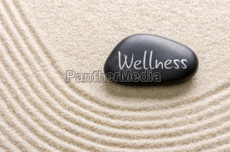 piedra negra etiquetada como wellness