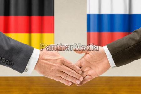 mano manos cooperacion acuerdo bandera asociacion