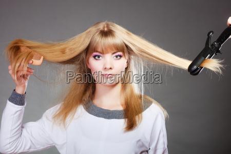 mujer herramienta instrumentos electrico peinado largo