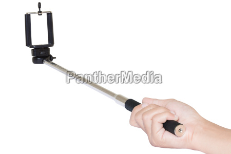 hand holding selfie stick isolated with