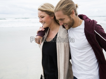 young man and young woman walking