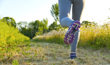 woman running in a field