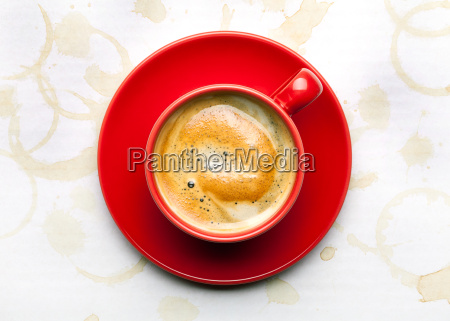 coffee cup with coffee stains background