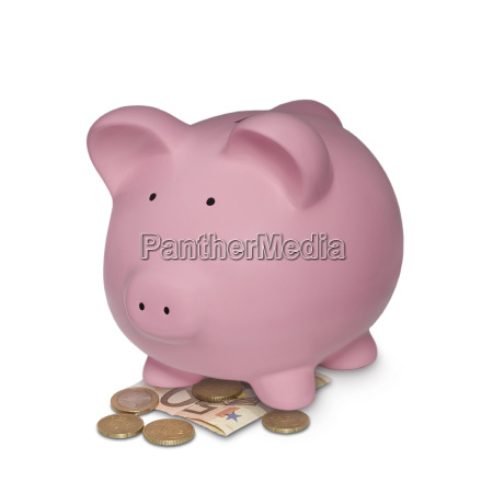 pink piggy bank with money