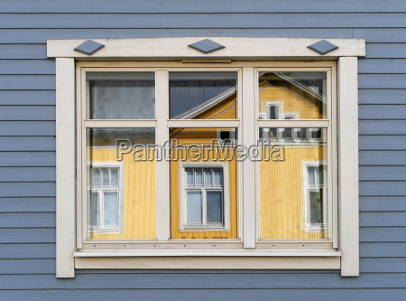 window of a wooden house in