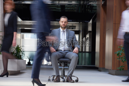 business man sitting in office chair