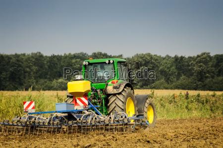 dispositivo mano de obra agricola tractor
