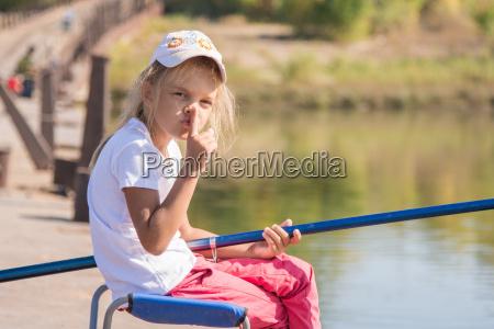 girl, fishing, calls, for, silence - 14923401