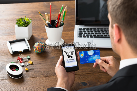 businessperson with credit card and mobile