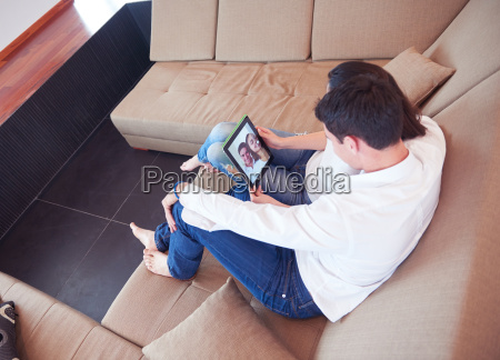 couple at modern home using tablet