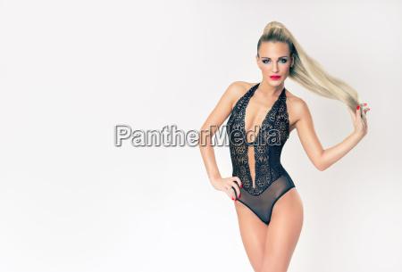 attractive slim blonde girl in black