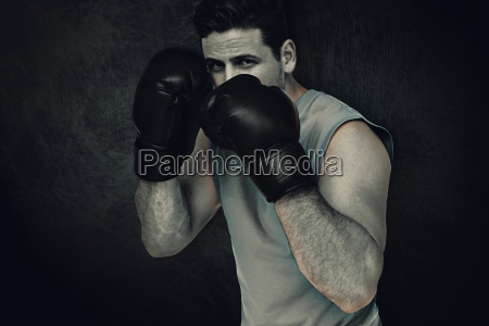 composite image of determined male boxer