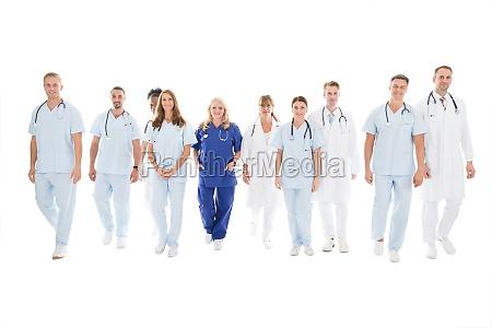 confident multiethnic medical team walking in