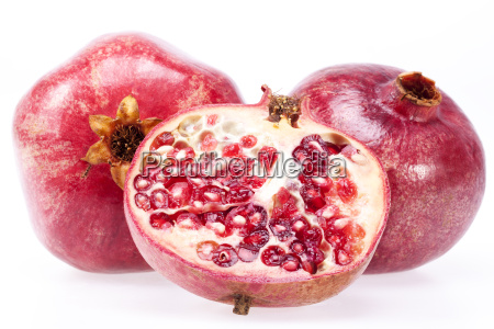 some fruits of red pomegranate isolated