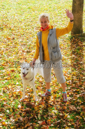 woman with dog walking on a