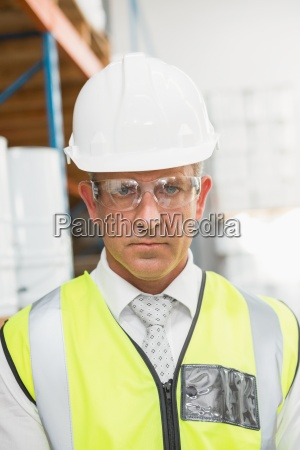 manager wearing hard hat in warehouse