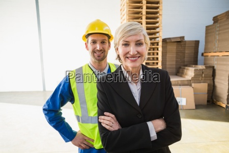 portrait of smiling warehouse worker and